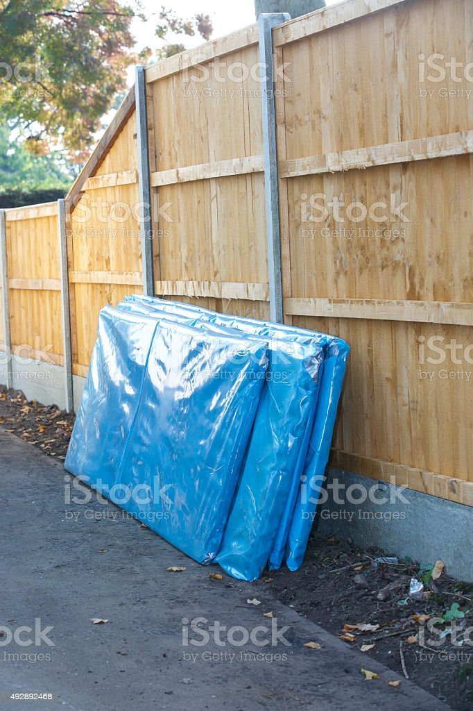 Asbestos corrugated roofing sheets sealed and ready for collection stock photo