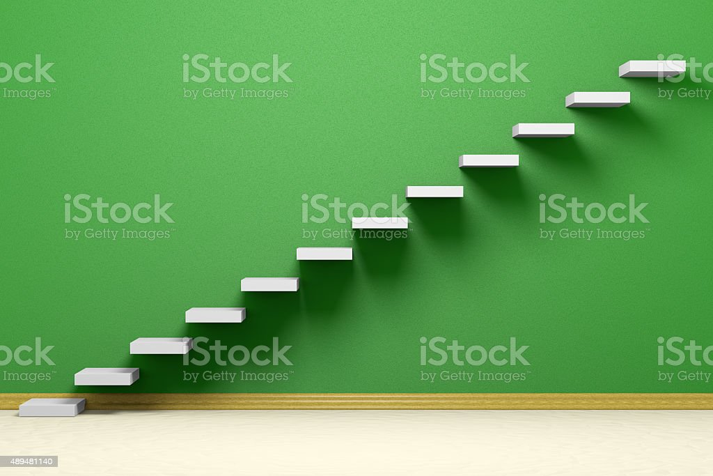 Ascending stairs of rising staircase in empty green room stock photo