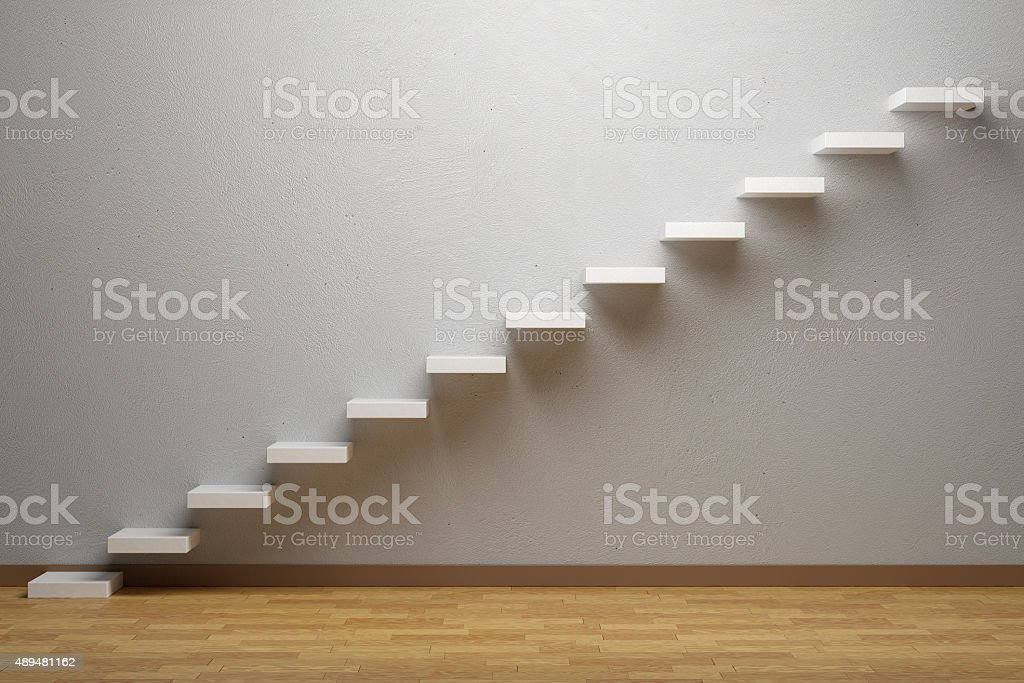 Ascending stairs of rising staircase in empty room with parquet stock photo