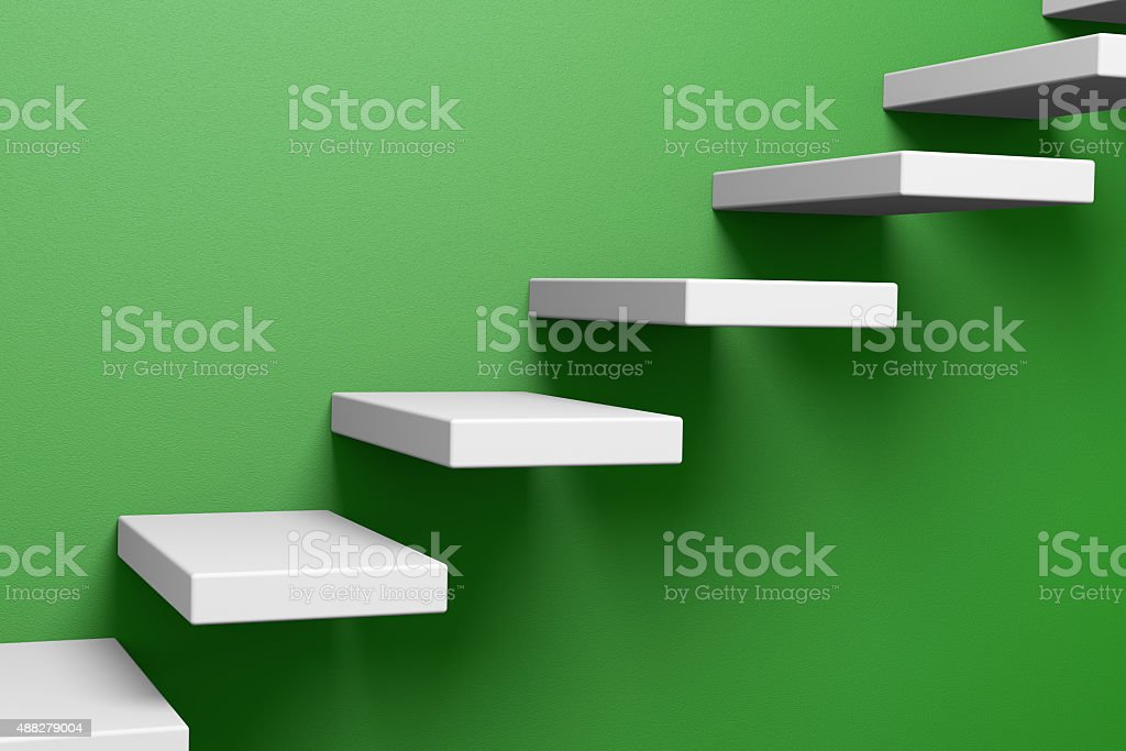 Ascending stairs on the green wall stock photo