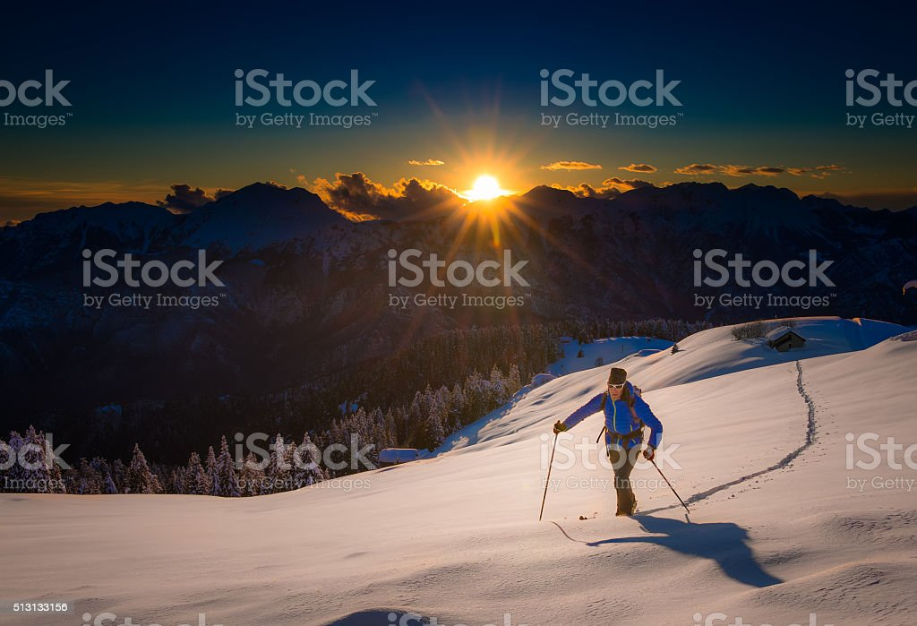 Ascending to the top. Ski mountaineering stock photo