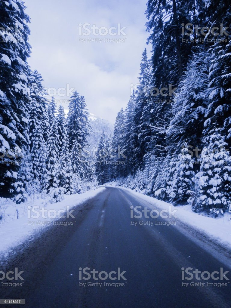 Asfaltovaya road in the winter mountains. stock photo
