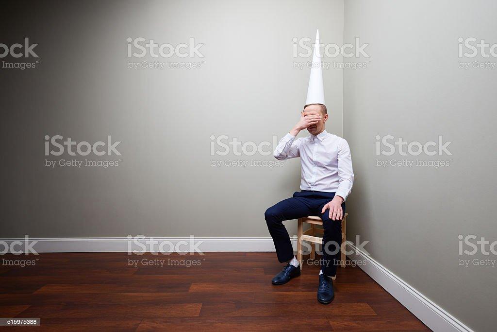 Ashamed dunce stock photo