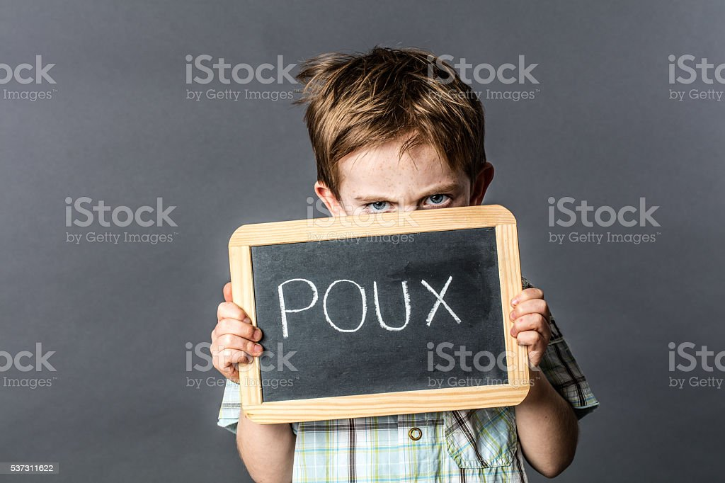 ashamed preschooler with unhappy blue eyes protecting from head lice stock photo
