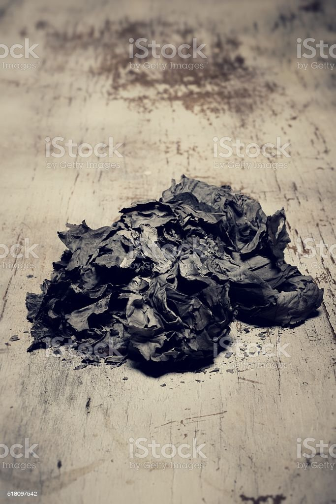 ashes on wooden table stock photo