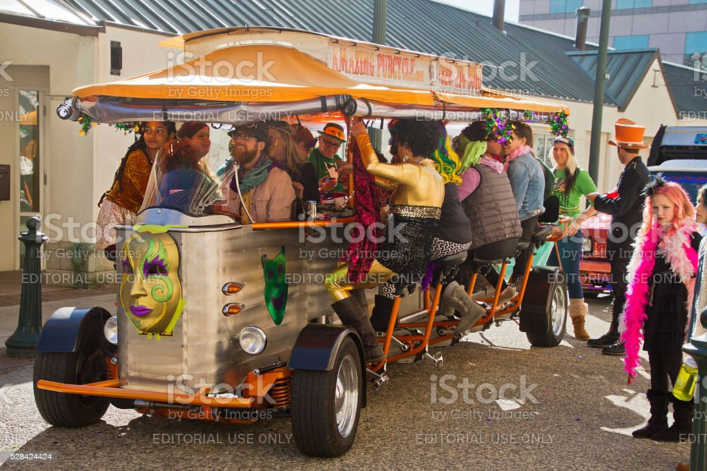 Asheville PubCycle Masked For Mardi Gras stock photo