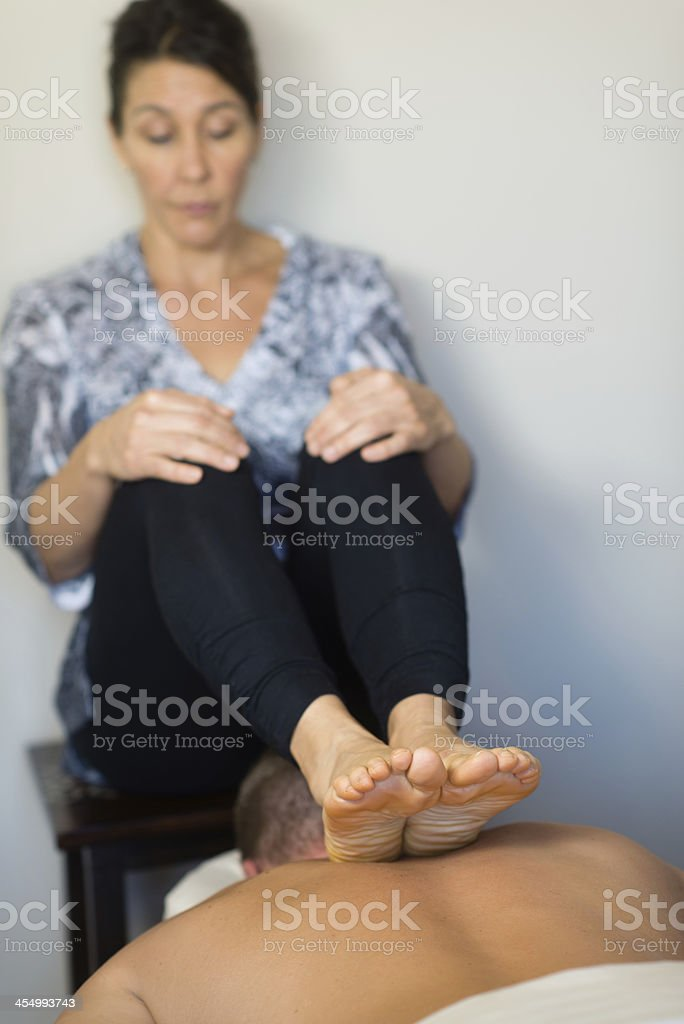 Ashiatsu Practitioner Giving Massage royalty-free stock photo