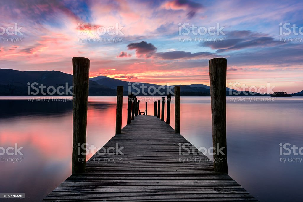Ashness Jetty With Pink And Purple Vibrant Sunset. stock photo