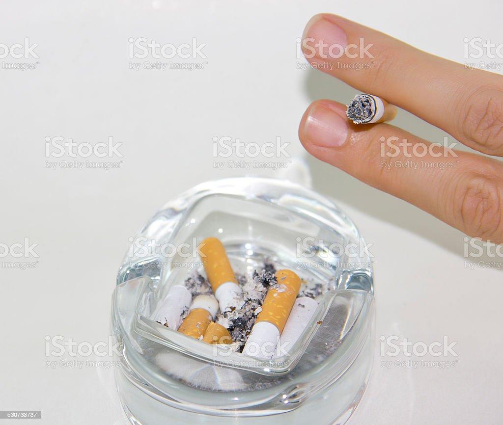 Ashtray and cigarettes stock photo