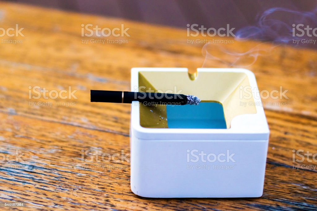 Ashtray & Cigarette. Smoking stock photo