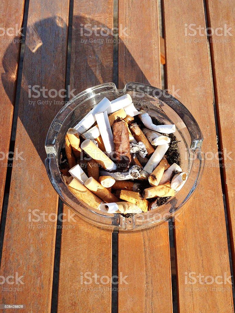 Ashtray on Wood Table stock photo