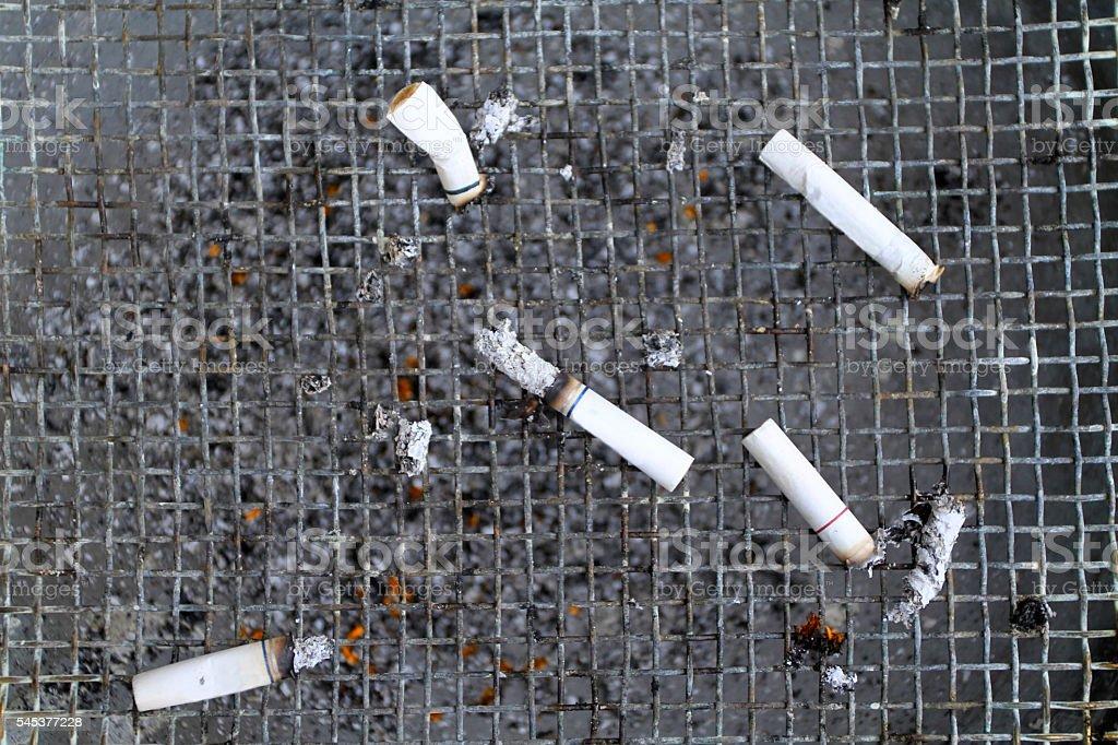 Ashtray with five cigarettes stock photo