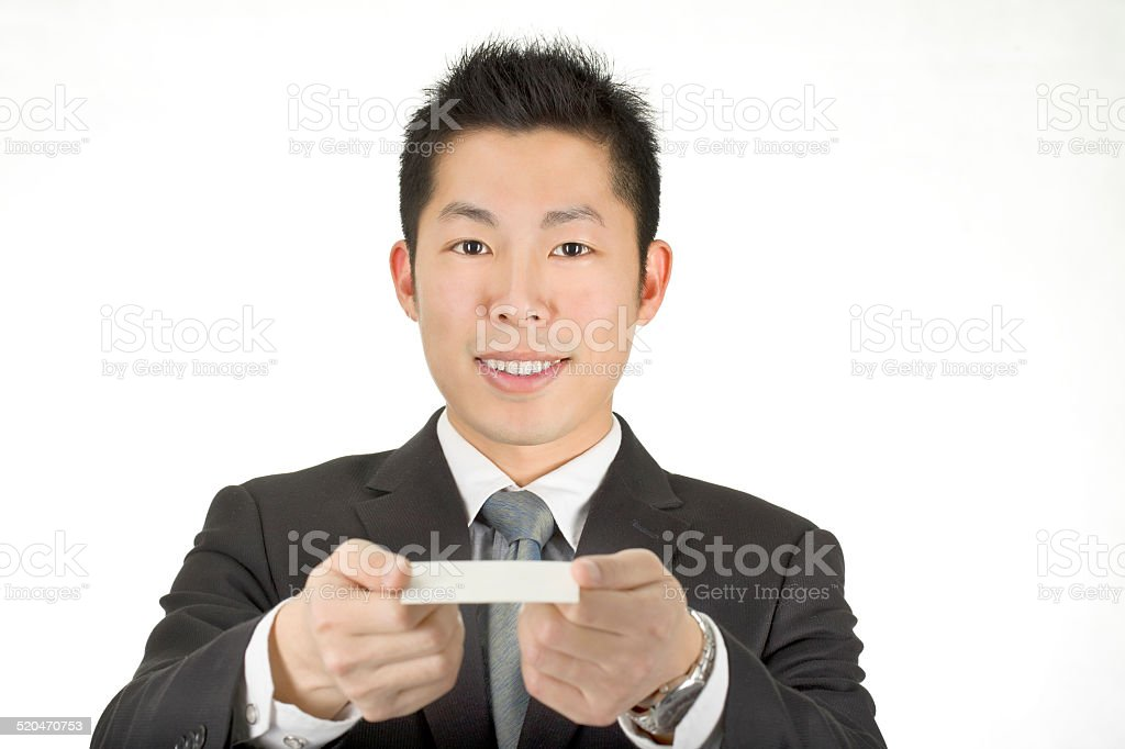 asia business man hold a card stock photo