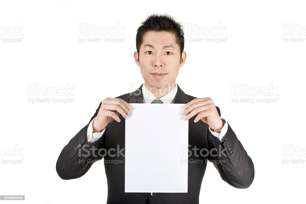 asia business man hold a paper card stock photo