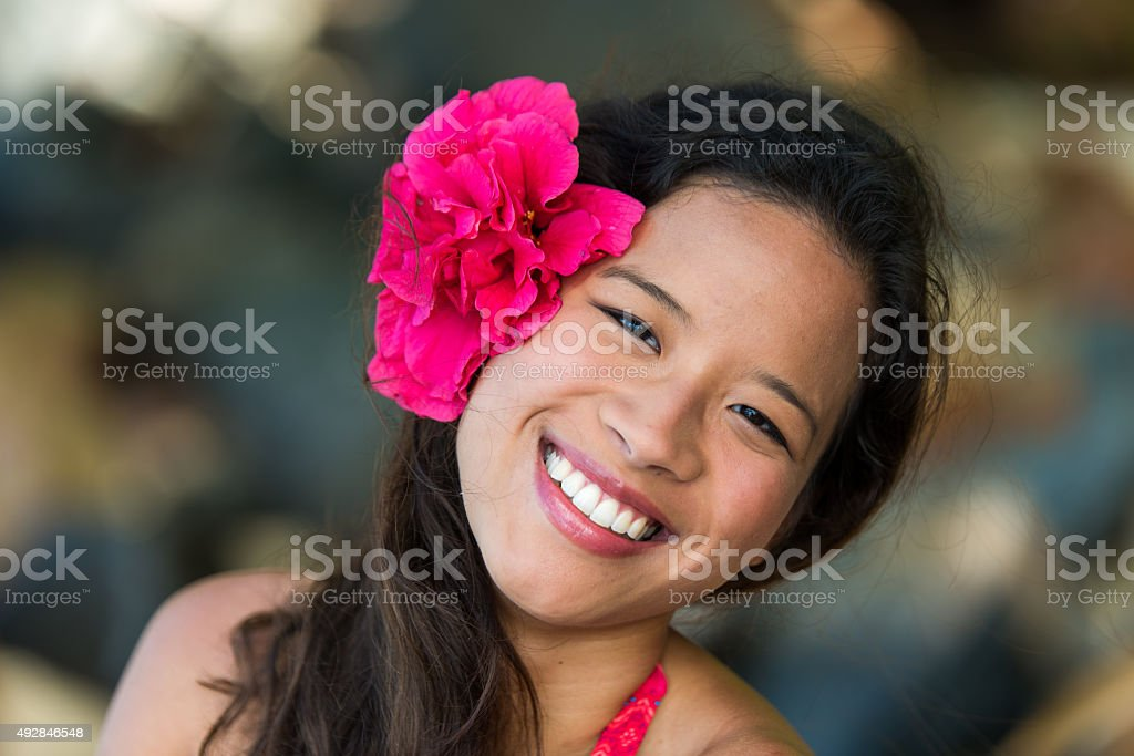 Asia Happy girl with flower stock photo