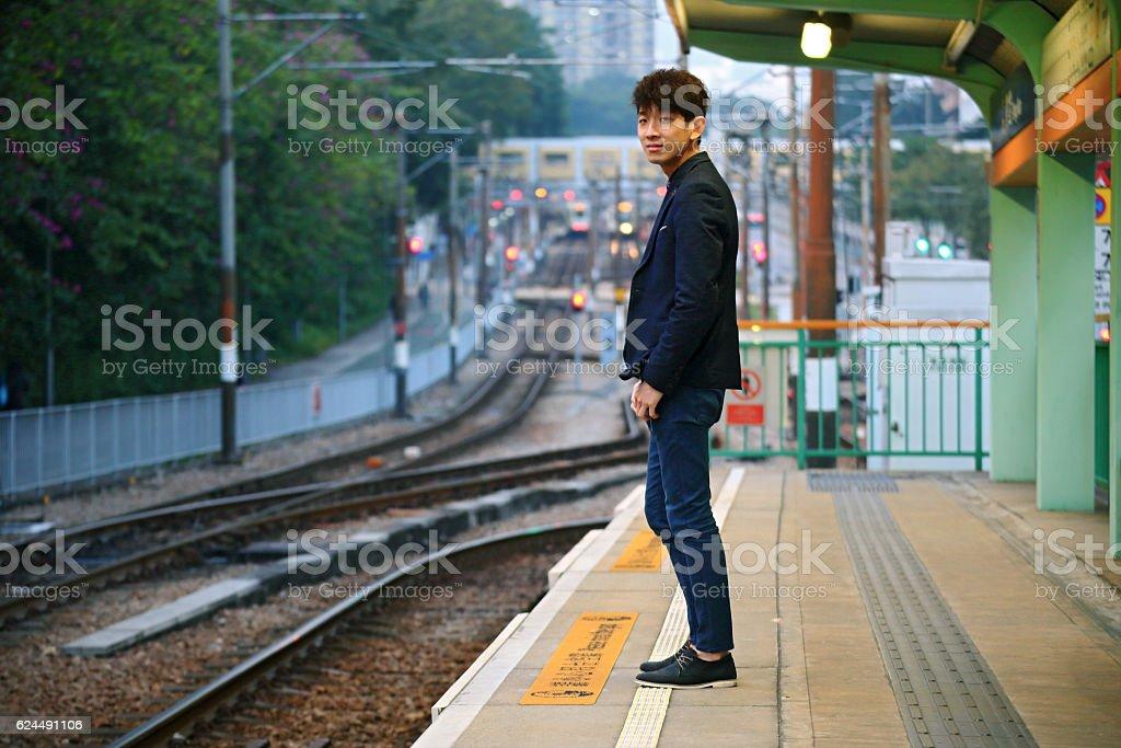 Asia man waiting train stock photo