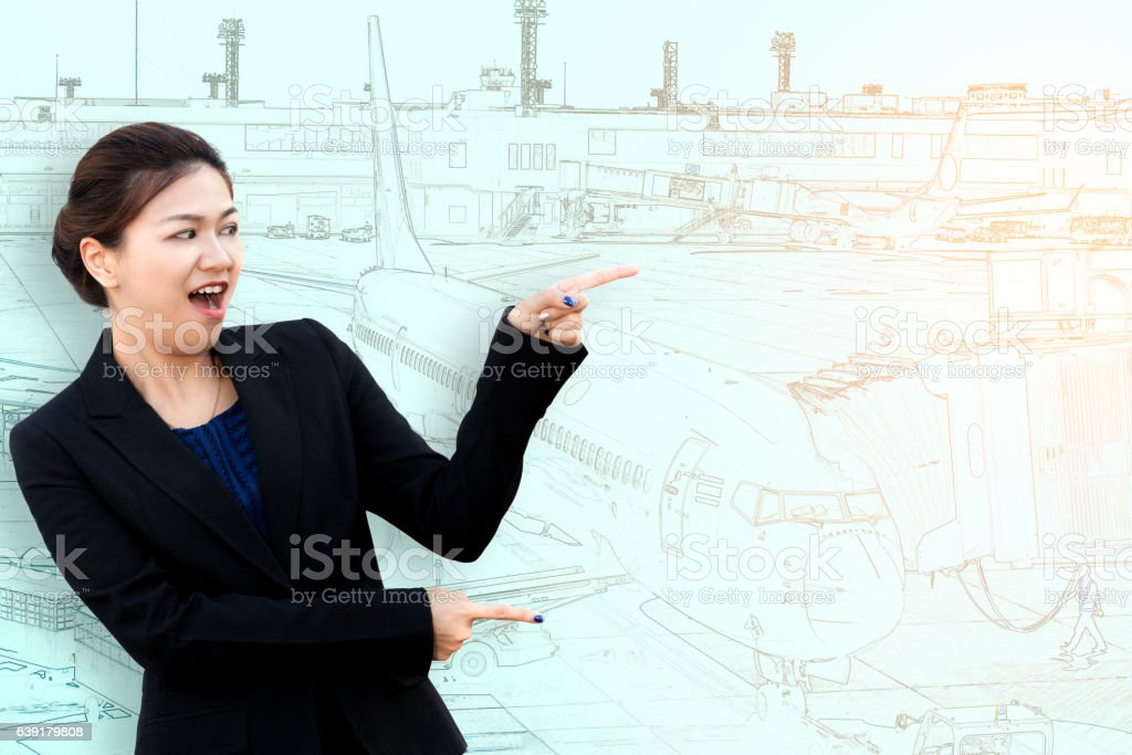 Asia surprised businesswoman pointing to side with aeroplane stock photo