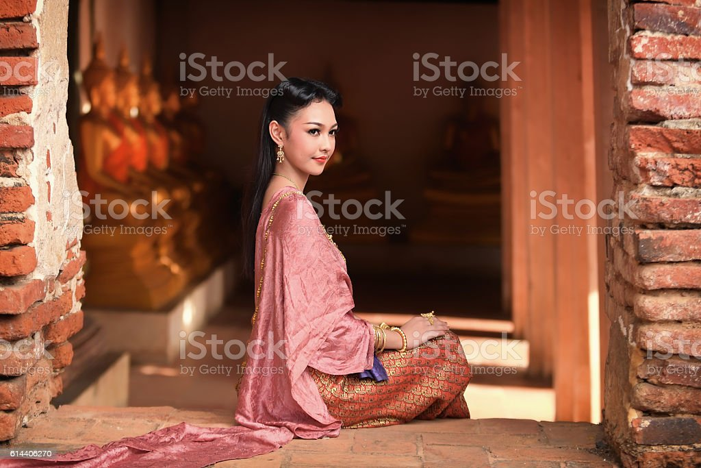 Asia woman in Thai dress traditional stock photo