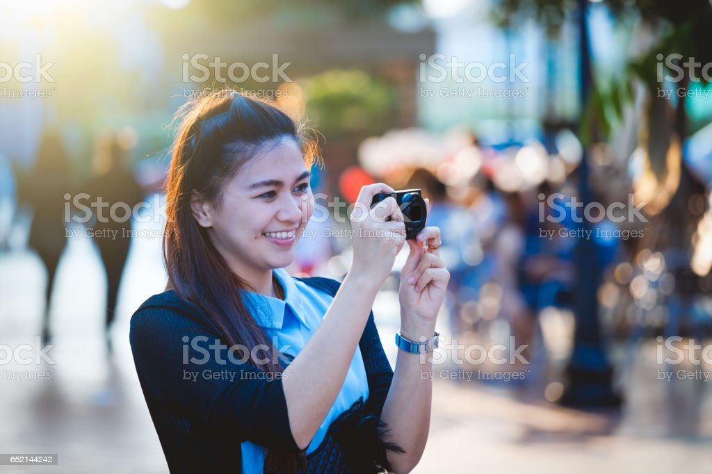 Asia women with camera in free day relax at city stock photo