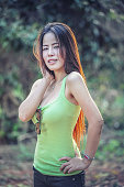 asia young Woman wearing green vest on park