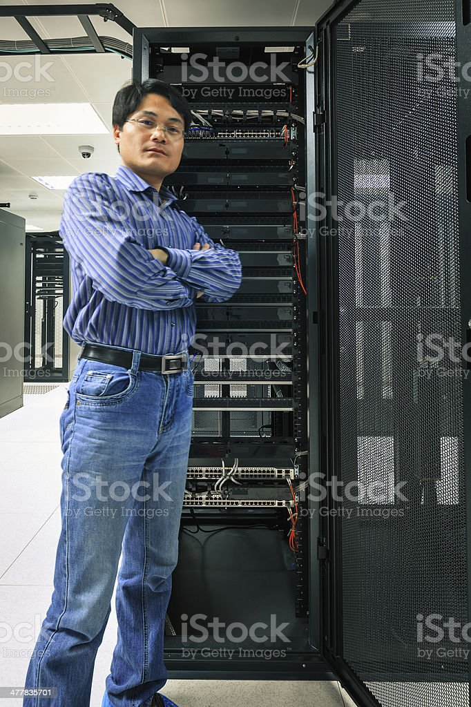 Asian administrator is working in the data  center room. royalty-free stock photo