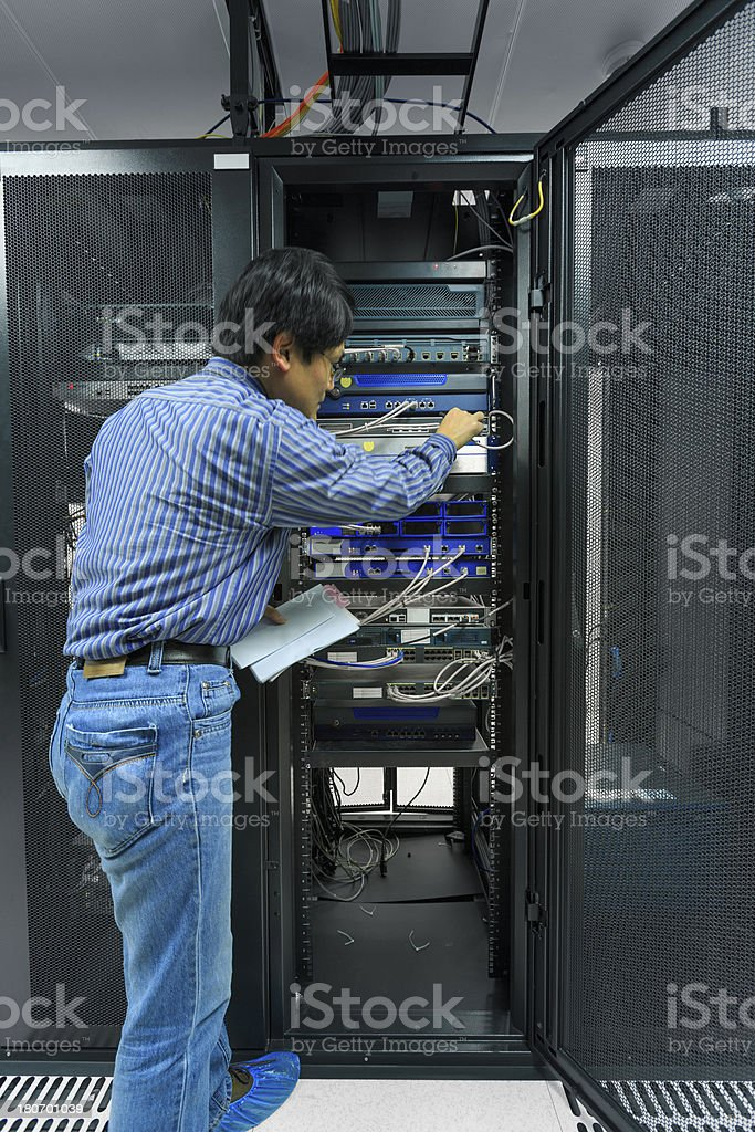 Asian administrator working in the data center. royalty-free stock photo