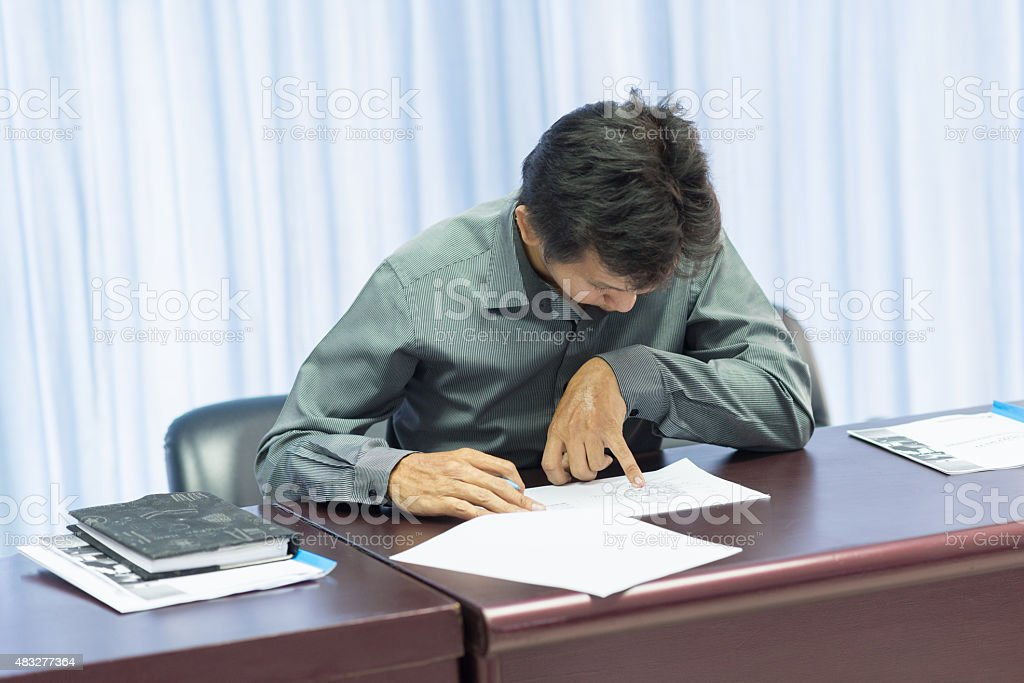Asian adult education student takes an exam. stock photo