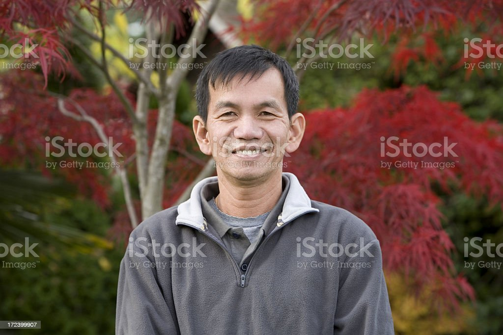 Asian Adult Male Smiling Portrait Outdoors, Copy Space stock photo