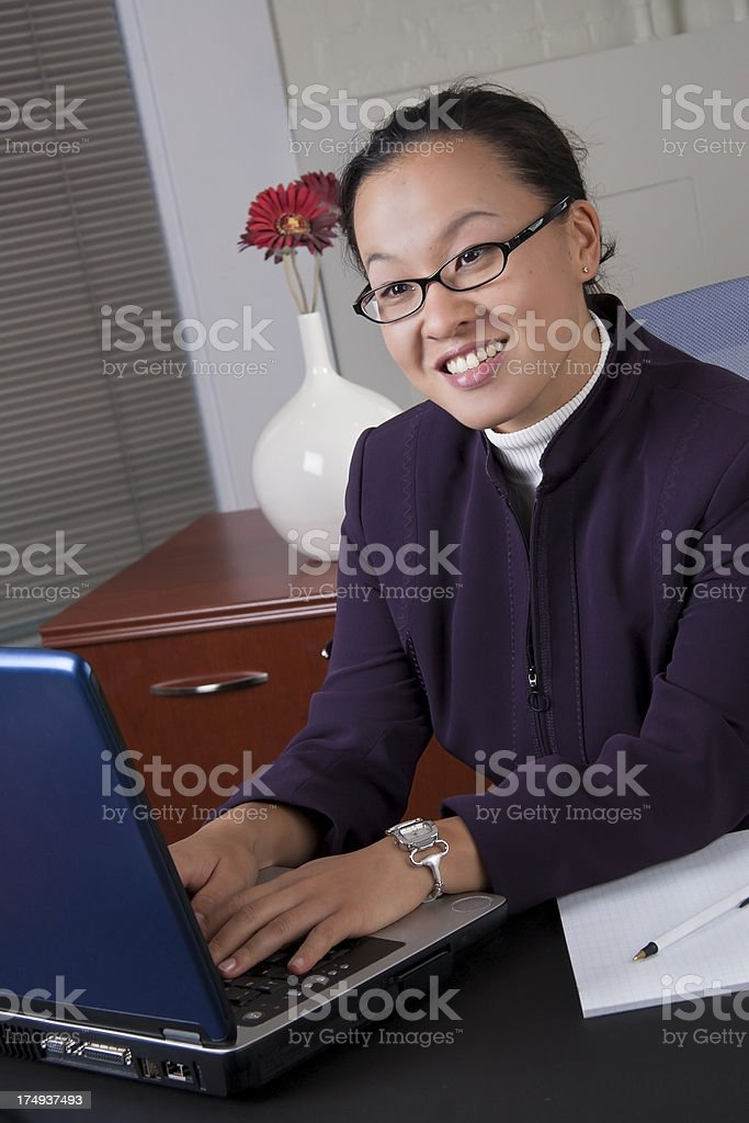 Asian American Business woman smiling with laptop royalty-free stock photo