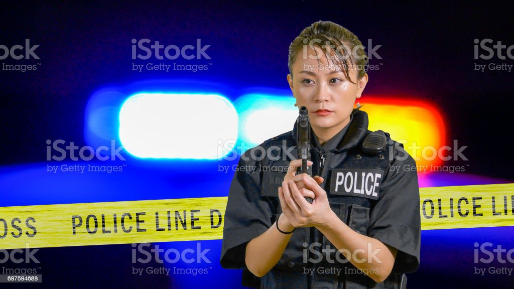 Asian American Policewoman with a pistol stock photo