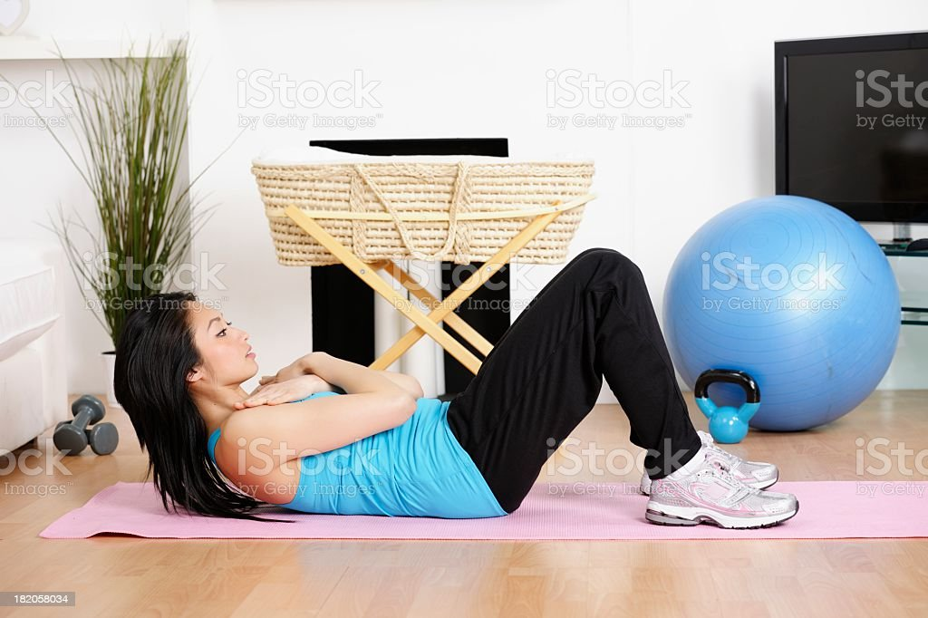 Asian American Woman Doing Post Natal Excerises stock photo
