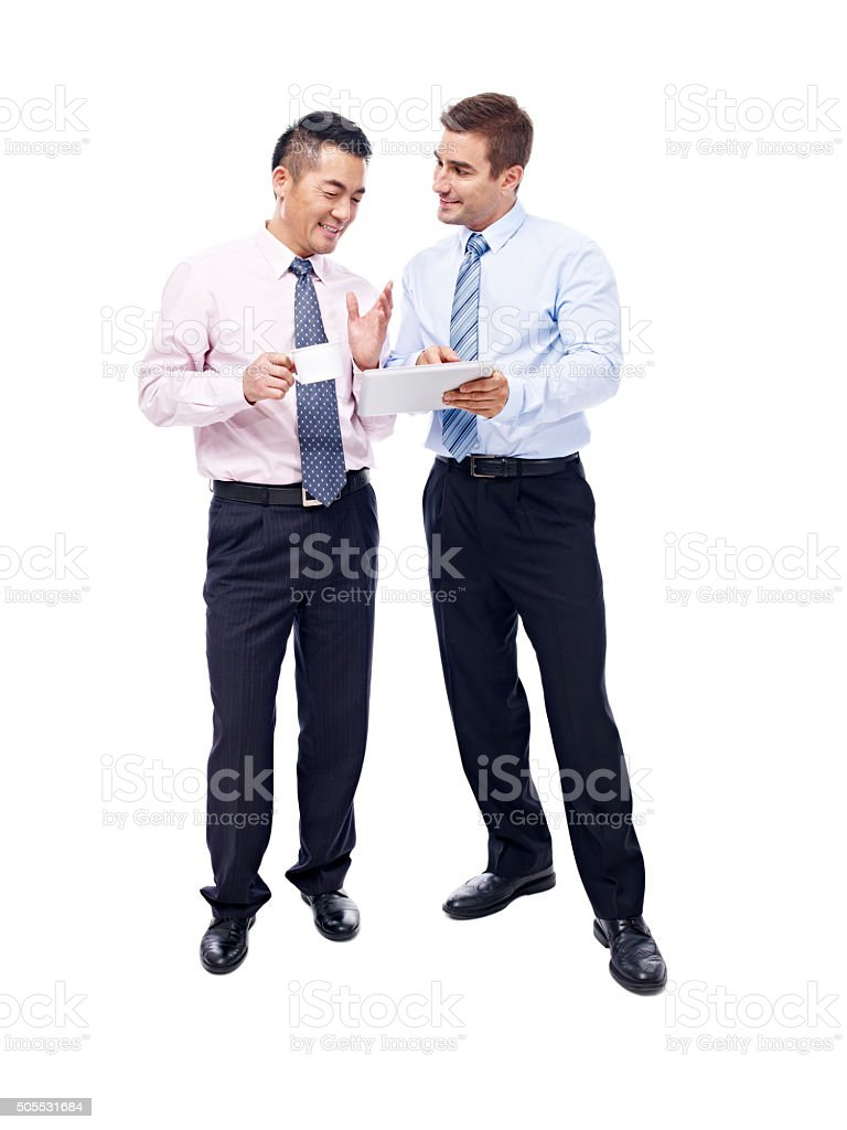 asian and caucasian businessmen having a  discussion stock photo