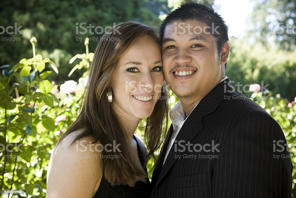 Asian and Caucasian Interracial Young Couple Portrait, Outdoors, Copy Space stock photo