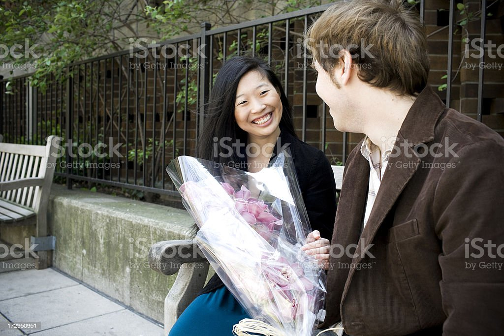 Asian and Caucasian Interracial Young Couple Smiling Outdoors, Copy Space royalty-free stock photo