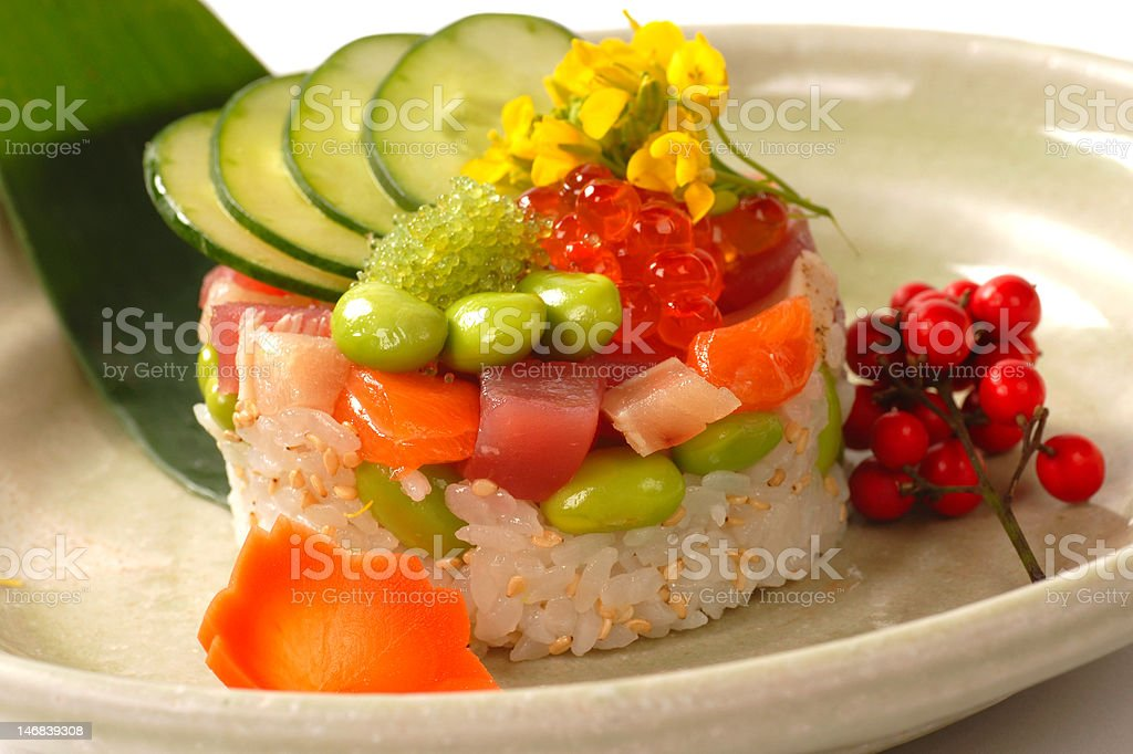 Asian appetizer of rice with tuna, salmon and vegetables royalty-free stock photo