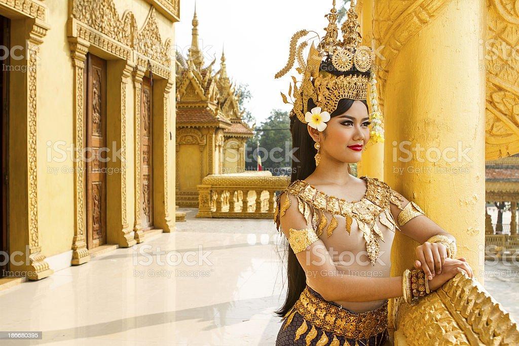 Asian Apsara woman dancer overlooking the temple stock photo