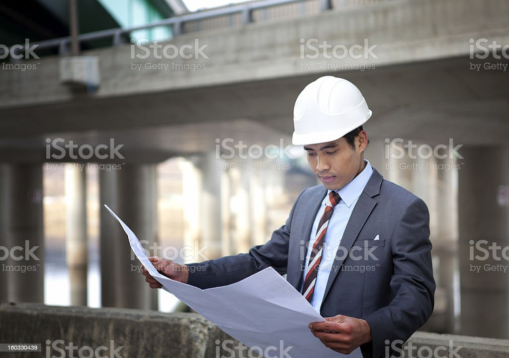 asian architect on highway construction site royalty-free stock photo
