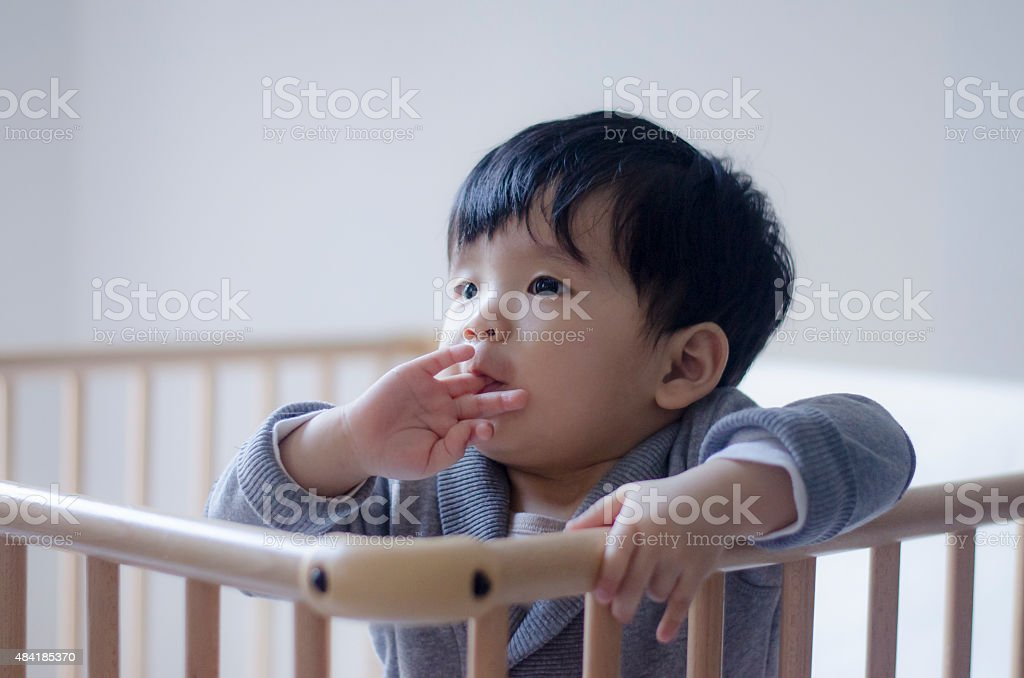 Asian Baby Boy in a playpen stock photo