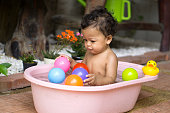 Asian baby boy taking a shower
