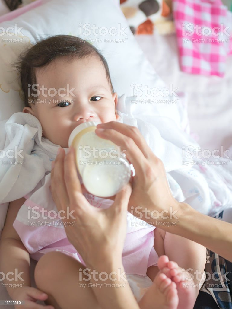 Asian baby eat milk from bottle. royalty-free stock photo