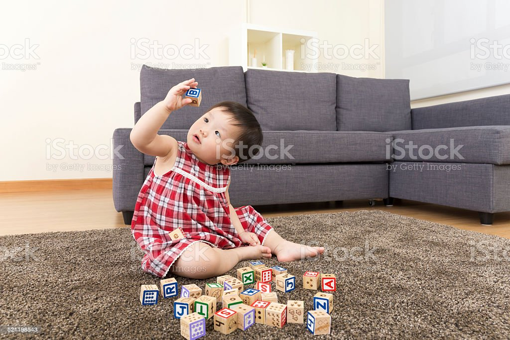 Asian baby girl playing toy block stock photo
