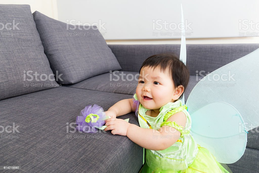 Asian baby girl wearing a halloween party costume stock photo