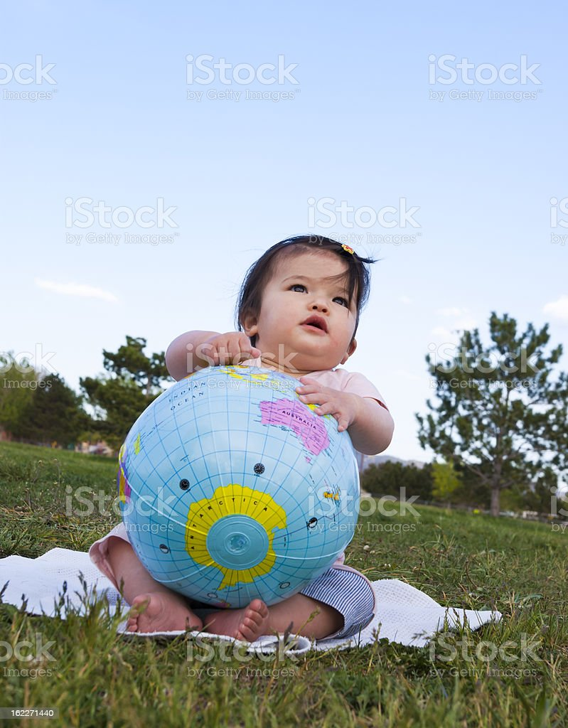 Asian baby holding world globe stock photo