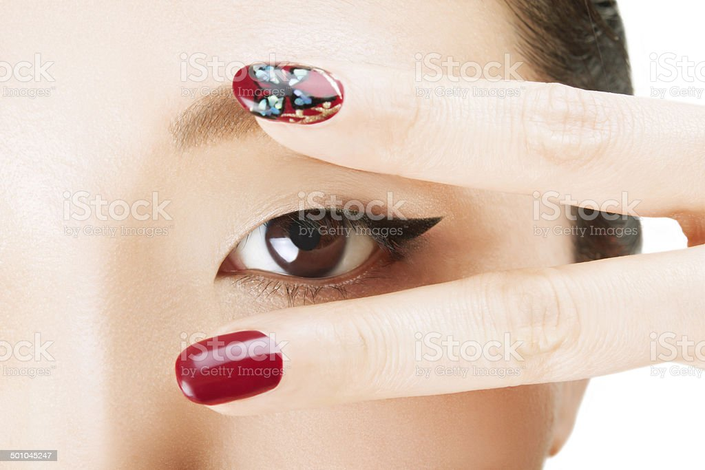 Asian beautiful eyes with V sighn and Nail art stock photo