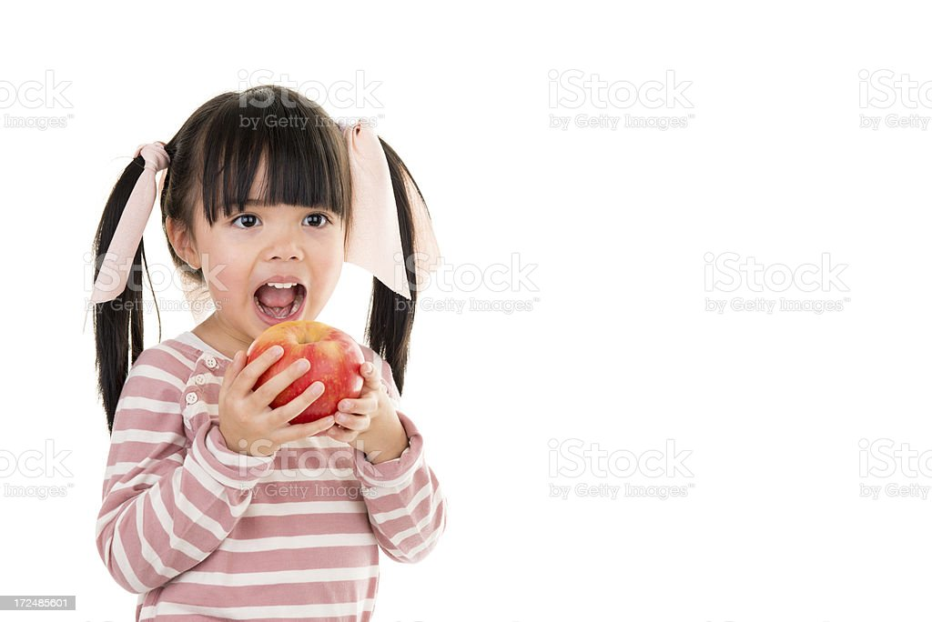 Asian beautiful little girl portrait with apple white background royalty-free stock photo