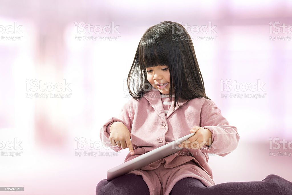 Asian beautiful little girl portrait with tablet royalty-free stock photo
