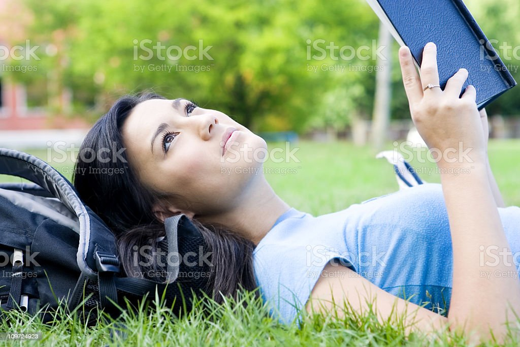 Asian Beautiful Teenage Girl on School Campus Grass with Backpack royalty-free stock photo