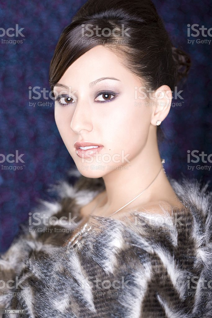 Asian Beautiful Young Woman in Jewelry and Fur, High Key royalty-free stock photo