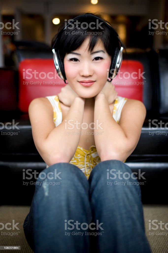 Asian Beautiful Young Woman with Headphones, Listening to Music royalty-free stock photo