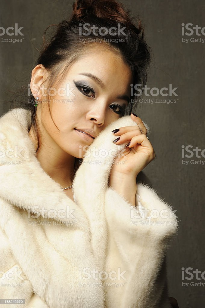 Asian beauty in white mink coat stock photo